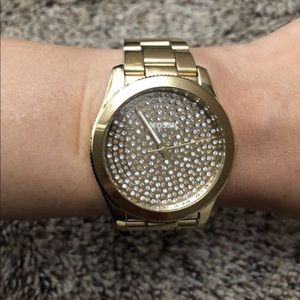 Women's fossil gold watch with diamonds